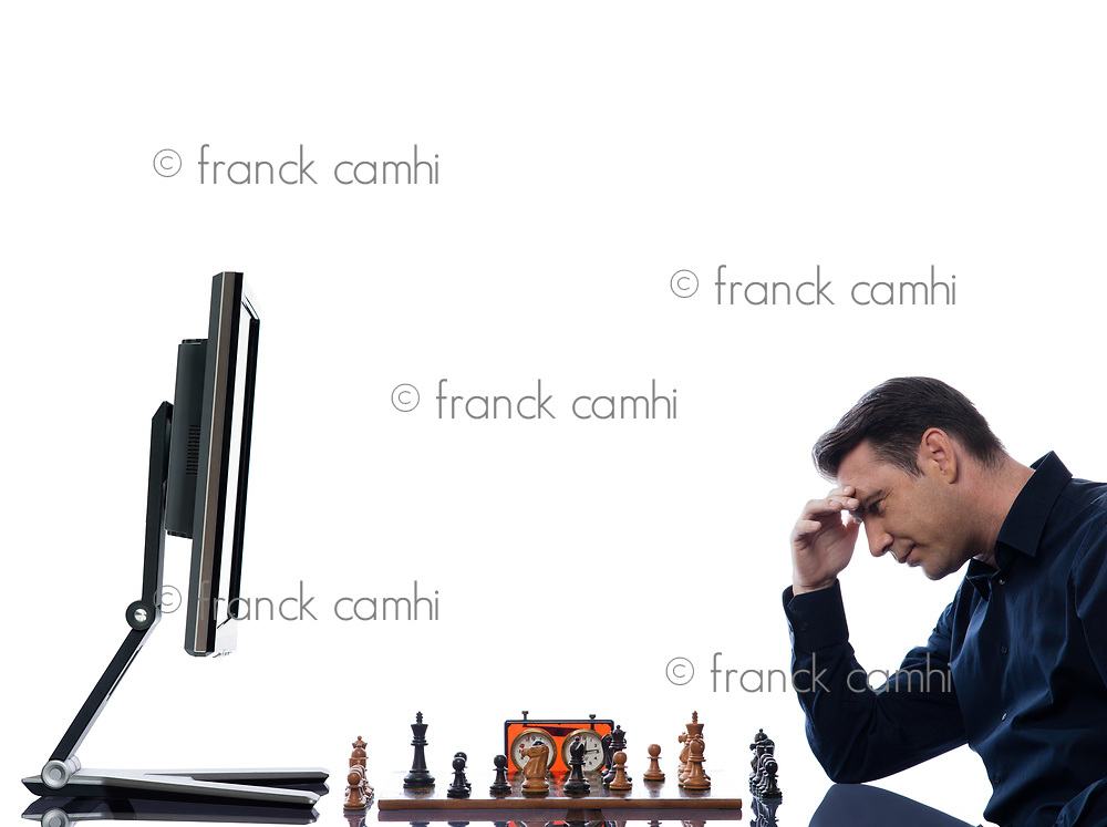 caucasian man playing chess concentrated against computer concept on isolated white background