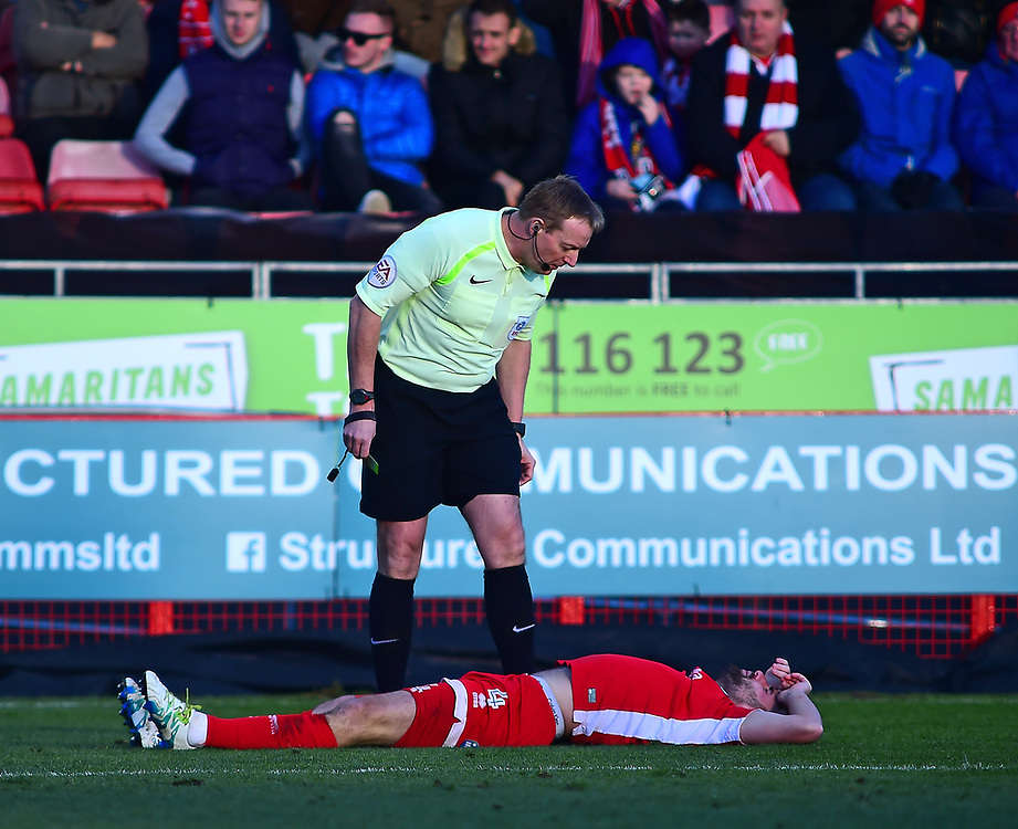 Crawley Town's Josh Paynenis shown a yellow card by Referee Trevor Kettle<br /> <br /> Photographer Andrew Vaughan/CameraSport<br /> <br /> The EFL Sky Bet League Two - Crawley Town v Lincoln City - Saturday 17th February 2018 - Broadfield Stadium - Crawley<br /> <br /> World Copyright © 2018 CameraSport. All rights reserved. 43 Linden Ave. Countesthorpe. Leicester. England. LE8 5PG - Tel: +44 (0) 116 277 4147 - admin@camerasport.com - www.camerasport.com