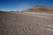 Roads in the desert in the Bolivian Altiplano, south of Uyuni. Each day many jeeps take tourists through the incredible landscape, past colourful flamingo-filled lakes, jagged volcanoes, and varied rock formations