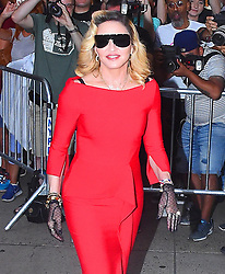 "Madonna is red hot as she wears a tight red dress while arriving to the ""Barney's"" for MDNA beauty launch. 26 Sep 2017 Pictured: Madonna. Photo credit: MEGA TheMegaAgency.com +1 888 505 6342"