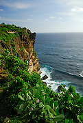 View of clifftops and surf, Uluwatu temple, Bali, Indonesia.