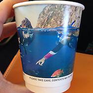 Darryl Torckler's Poor Knights split level image image on an Air New Zealand cup. Image taken for Air New Zealand, cup image taken by Kate Malcolm of Tutukaka Dive. https://www.facebook.com/HippyKate?fref=ts