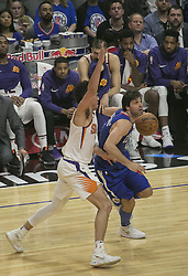 October 21, 2017 - Los Angeles, California, U.S - Milos Teodosic #4 of the Los Angeles Clippers and Devin Booker #1 of the Phoenix Suns during their regular season game on Saturday October 21, 2017 at the Staples Center in Los Angeles, California. Clippers defeat Suns, 130-88. (Credit Image: © Prensa Internacional via ZUMA Wire)