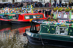 © Licensed to London News Pictures. 30/04/2016. London, UK. Canalway Cavalcade festival takes place in Little Venice, London on Saturday, 30 April 2016. Inland Waterways Association's annual gathering of canal boats brings around 130 decorated boats together in Little Venice's canals on May bank holiday weekend. Photo credit: Tolga Akmen/LNP