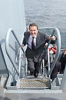 09 AUG 2001, OSTSEE/GERMANY:<br /> Gerhard Schroeder, SPD, Bundeskanzler, waehrend einem Besuch von Marineeinheiten im Seegebiet vor Rostock auf dem Tender DONAU<br /> IMAGE: 20010809-01-007<br /> KEYWORDS: Bundeswehr, Bundesmarine, Marine, Gerhard Schröder, Treppe, Stufen