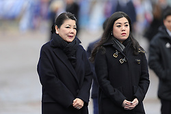 The wife and daughter of Leicester City owner, Vichai Srivaddhanaprabha view the tribute site near to Leicester City Football ClubÕs King Power Stadium, ahead of a visit by the Duke and Duchess of Cambridge to pay tribute to those who were killed in the helicopter crash last month.