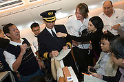 Airbus A380 first commercial flight - Singapore Airlines SQ 380 Singapore-Sydney on October 25, 2007. Captain Robert Ting signing for passengers.