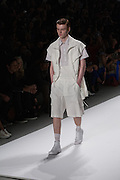 An off-white men's short outfit with cape-sleeved jacket by Richard Chai at the Spring 2013 Mercedes Benz Fashion Week show in New York.