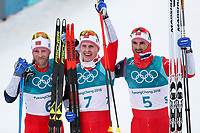 PYEONGCHANG,SOUTH KOREA.11.FEB.18 - OLYMPICS, NORDIC SKIING, CROSS COUNTRY SKIING - Olympic Winter Games PyeongChang 2018, 15 + 15 km Skiathlon, men. Image shows the rejoicing of Martin Johnsrud Sundby (NOR), Simen Hegstad Krueger (NOR) and Hans Christer Holund (NOR). <br /> <br /> Norway only
