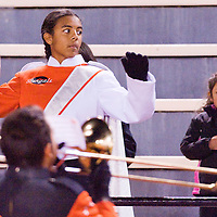 110112       Cable Hoover<br /> <br /> Gallup High School drum major Danielle Hutchinson conducts the National Anthem as the Bengals prepare to face the Grants Pirates Friday at Public School Stadium.