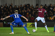 West Ham United defender Issa Diop (23) and Wimbledon midfielder Mitch Pinnock (11) in action during the The FA Cup fourth round match between AFC Wimbledon and West Ham United at the Cherry Red Records Stadium, Kingston, England on 26 January 2019.