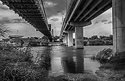 Looking across into Mexico. On the bank of the Rio Grande River, under the international bridge in Roma, TX, USA