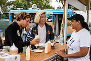Queens, NY - October 2, 2016. Danny Miller (L) and Max Harwoodof the band Lewis del Mar puttng sour cream on arepas from The Arepa Lady at The Feastival of Queens at The Meadows festival at Citi Field.