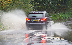 ©Licensed to London News Pictures 13/10/2020  <br /> Crockenhill, UK. A car driving through flood water on Eynsford Road, Crockenhill, Kent. Very wet driving conditions with some roads flooding this afternoon in Kent as the rain continues. Photo credit:Grant Falvey/LNP