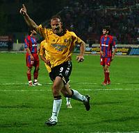 Photo. Daniel Hambury.<br /> UEFA Cup.<br /> Panionios V Newcastle United. 21/10/2004.<br /> Newcastle's Alan Shearer celebrates scoring