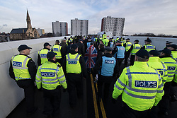 © Licensed to London News Pictures . 20/01/2018. Doncaster, UK. Far-right street protest movement , the English Defence League ( EDL ) , march after holding a demonstration , opposed by anti-fascists , including Unite Against Fascism ( UAF ) in the Hexthorpe area of Doncaster . EDL supporters chanted anti-Roma slogans as they marched through the town . Photo credit: Joel Goodman/LNP