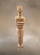 Marble female Cycladic statue figurine with folded arms of the Spedos type. Early Cycladic Period II (2800-2300 BC) from Naxos, Cat No 6195. National Archaeological Museum, Athens. <br /> <br /> This Cycladic statue figurine is of the Spedos type standing on tip tie with bended knees and arms folded under the breasts with head raiised. .<br /> <br /> If you prefer to buy from our ALAMY PHOTO LIBRARY  Collection visit : https://www.alamy.com/portfolio/paul-williams-funkystock/cycladic-art-artefacts.html Type into the LOWER SEARCH WITHIN GALLERY box to refine search by adding background colour, place, museum etc<br /> <br /> Visit our CYCLADIC CIVILISATIONS PHOTO COLLECTIONS for more photos to download or buy as wall art prints https://funkystock.photoshelter.com/gallery-collection/Cycladic-civilisation-Ancient-Greek-Artefacts-art-Photos-Pictures-Images/C0000CmevVvnC.XU