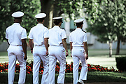 Cadets in sevice whites march on the campus of the US Naval Academy, Annapolis, Maryland, USA