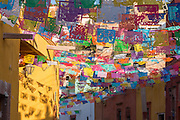 Festive papel picado banners decorate Calle Aparicio in the historic center of San Miguel de Allende, Mexico.
