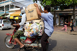 Two Men On Motobike with Large Boxes