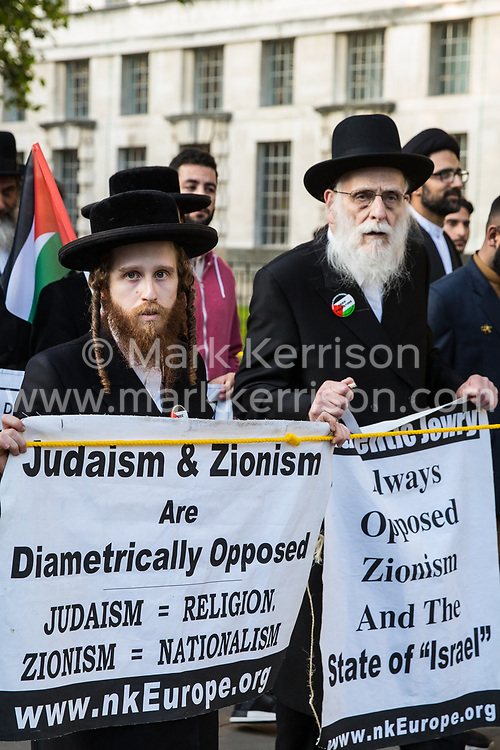 London, UK. 10th June, 2018. Orthodox Haredi Jews from Neturei Karta lead hundreds of people taking part in the pro-Palestinian Al Quds Day march through central London organised by the Islamic Human Rights Commission. An international event, it began in Iran in 1979. Quds is the Arabic name for Jerusalem.