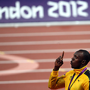 Usain Bolt, Jamaica, at the Men's 100m Gold Medal presentation at the Olympic Stadium, Olympic Park, during the London 2012 Olympic games. London, UK. 5th August 2012. Photo Tim Clayton