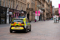 Glasgow, Scotland, UK. 1 April, 2020. Effects of Coronavirus lockdown on Glasgow life, Scotland. Police patrol an empty Buchanan street the main shopping street in Glasgow.