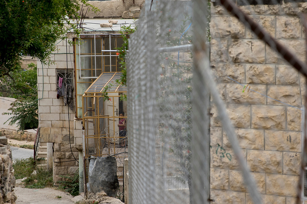 Palestinians living in Hebron have to heavily protect their homes against attacks by Jewish settlers who illegally live in the West Bank