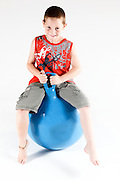 Indoor playground child on Space hopper  On white Background