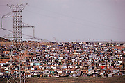 """View of the shantytown called """"Silvertown"""", near Soweto, outside Johannesburg, South Africa. Material World Project."""