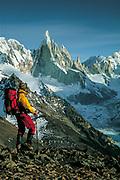 Trekker views Cerro Torre,  Los Glaciares National Park, Patagonia, Argentina.