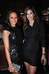 MELANIE BROWN and CINDY CRAWFORD at a party to celebrate the launch of the Omega 2009 Constellation Collection of watches held at Almada, Berkeley Street, London on 15th October 2009.