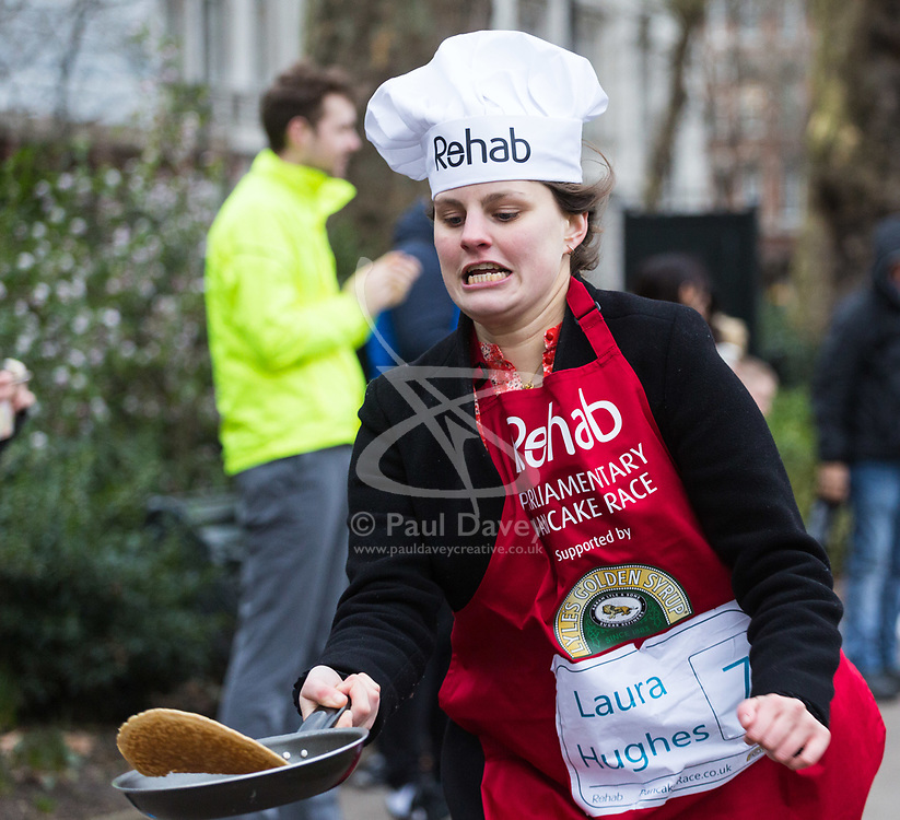 MPs and members of the House of Lords compete in the annual Rehab pancake race, a relay of eleven laps in Victoria Tower Gardens adjacent to the Houses of Parliament in London. The race is held every year on Shrove Tuesday and was won by the Media team. PICTURED: Laura Hughes from the Financial Times. London, February 13 2018.