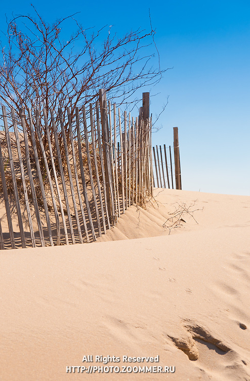 Cape Cod beach fence and sand dunes at beach entrance in Chatham, Cape Cod