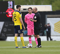 The captains, Oxford United's Elliott Moore and Blackpool's Chris Maxwell<br /> <br /> Photographer Rob Newell/CameraSport<br /> <br /> Sky Bet League One Play-Off Semi-Final 1st Leg - Oxford United v Blackpool - Tuesday 18th May 2021 - Kassam Stadium - Oxford<br /> <br /> World Copyright © 2021 CameraSport. All rights reserved. 43 Linden Ave. Countesthorpe. Leicester. England. LE8 5PG - Tel: +44 (0) 116 277 4147 - admin@camerasport.com - www.camerasport.com