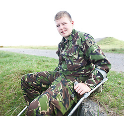 Kyle Armstrong. Injured his knee..Exercise Guards Warrior with the Scots Guards at their Catterick base..Pic ©2010 Michael Schofield. All Rights Reserved.