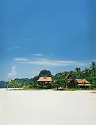 Villas on the white sand beach.