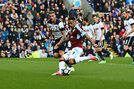Andre Gray of Burnley looks to shoot while Toby Alderweireld of Tottenham Hotspur looks on. Premier League match, Burnley v Tottenham Hotspur at Turf Moor in Burnley , Lancs on Saturday 1st April 2017.<br /> pic by Chris Stading, Andrew Orchard sports photography.