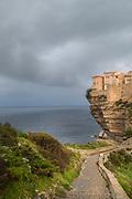 Citadel on cliff and sea under overcast sky, Bonifacio, Corsica, France