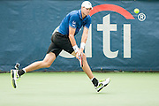 USA's John Isner hits a return to Cypress' Marcos Baghdatis during their men's quarterfinals singles match at the Citi Open ATP tennis tournament in Washington, DC, USA, 2 Aug 2013. Isner won the match 6-7, 6-4, 6-4 to advance to the semifinals on Saturday.
