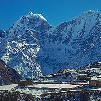 Mounts Kangtega & Thamserku tower behind Dole village in the Khumbu region of Nepal's Himalaya.