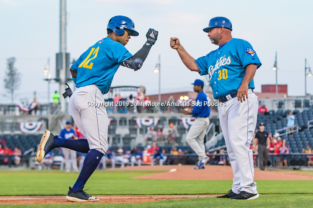 Amarillo Sod Poodles outfielder Buddy Reed (12) and Amarillo Sod Poodles Manager Phillip Wellman after Reed hit a home run against the Tulsa Drillers during the Texas League Championship on Tuesday, September 10, 2019, at HODGETOWN in Amarillo, Texas. [Photo by John Moore/Amarillo Sod Poodles]