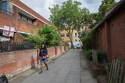 Street life in Somers Town on 26th June 2016 in London, United Kingdom. Somers Town, a district in north west London, is a large housing estate nestled between Euston, St Pancras and Kings Cross Library. Predominantly filled with social housing for the past 200 years, much of the area's housing was built in the twentieth century by the local authority.