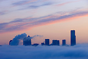 Several Seattle skyscrapers climb above the fog that settled in over Puget Sound at sunrise. Among the buildings in this image are the Columbia Tower at far right (Seattle's tallest building) and the Washington Mutual Tower, which has the pyramid-shaped roof.