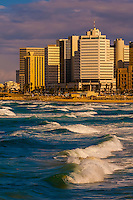 Waves from the Mediterranean Sea with the beach front of Tel Aviv, Israel.