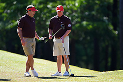 Kirby Smart talks to David Dukes during the Chick-fil-A Peach Bowl Challenge at the Oconee Golf Course at Reynolds Plantation, Sunday, May 1, 2018, in Greensboro, Georgia. (Dale Zanine via Abell Images for Chick-fil-A Peach Bowl Challenge)