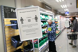 Shoppers in a local CoOp observe the 2 metre distance signs whilst buying groceries as the UK continues in lockdown to help curb the spread of the coronavirus.
