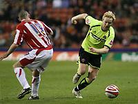 Photo: Mark Stephenson/Sportsbeat Images.<br /> Stoke City v Sheffield United. Coca Cola Championship. 10/11/2007.Sheffield's David Carney (R ) goes past Stokes Stephen Wright