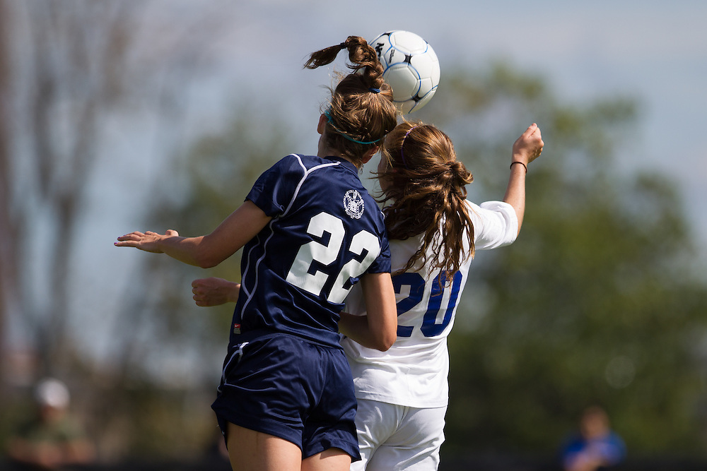 Catherine McClure, of Colby College, and Elisa Dolan, of Trinity College, go up for a header in a NCAA Division III soccer game on September 21, 2013 in Waterville, ME. (Dustin Satloff/Colby College Athletics)
