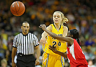January 08 2010: Iowa guard Jaime Printy (24) passes the ball around Ohio St. guard Amber Stokes (3) during the first half of an NCAA womens college basketball game at Carver-Hawkeye Arena in Iowa City, Iowa on January 08, 2010. Iowa defeated Ohio State 89-76.